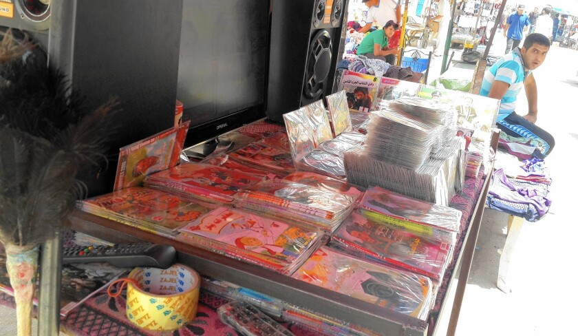 Stalls in Bab Sharqi sell nationalistic and Shiite militia CDs meant to inspire Iraqis in their fight against Islamic State.