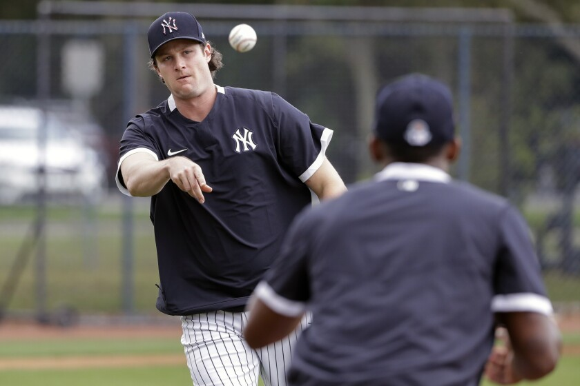 Yankees pitcher Gerrit Cole throws to first base a spring training practice drill.