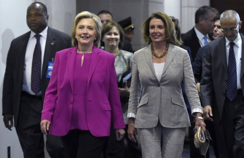 Democratic presidential candidate Hillary Rodham Clinton, left, walks with House Minority Leader Nancy Pelosi (D-San Francisco) at the Capitol after the announcement of a deal with Iran on its nuclear program. Pelosi has not publicly endorsed a presidential candidate.