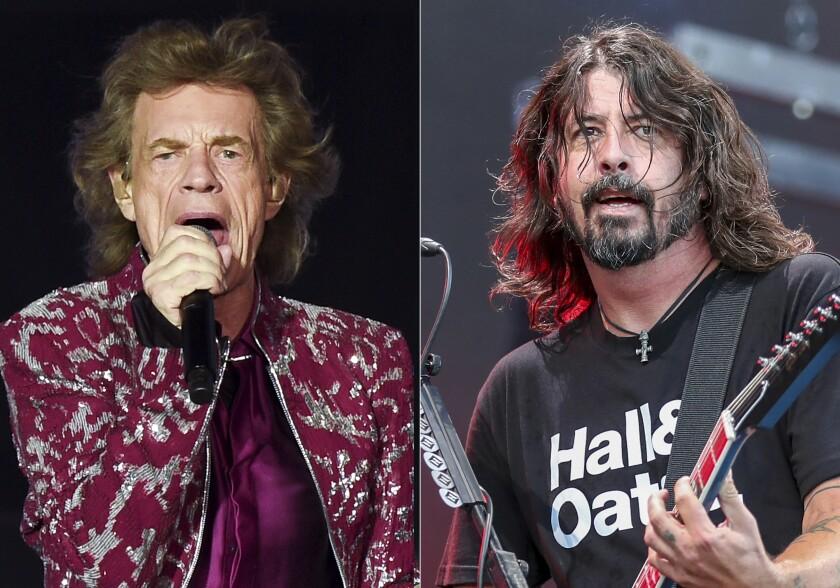 Mick Jagger, vocalista de The Rolling Stones izquierda, y Dave Grohl de los Foo Fighters