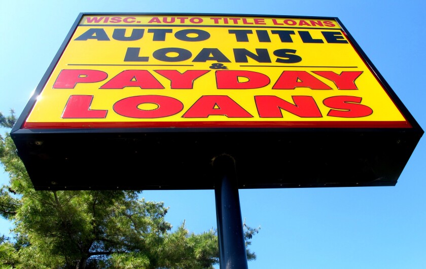 A sign for a Wisconsin Auto Title Loans store in Madison, Wis., in 2010.