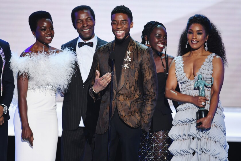 """The cast of """"Black Panther"""" accepts Outstanding Performance by a Cast in a Motion Picture onstage during the 25th Annual Screen Actors Guild Awards at The Shrine Auditorium on January 27, 2019 in Los Angeles, California."""