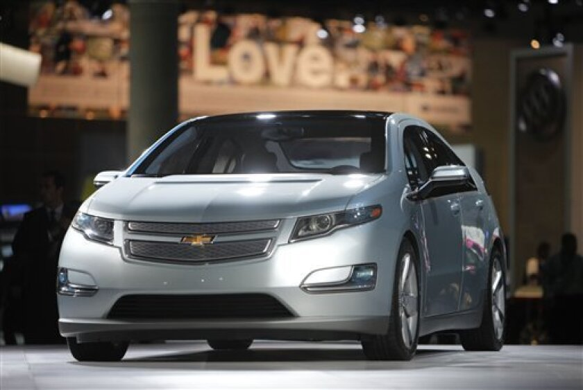 FILE - In this file photograph taken Dec. 2, 2009, the 2011 Chevrolet Volt debuts at the Los Angeles Auto Show, in Los Angeles. General Motors will strengthen the structure around the batteries in its Volt electric cars to keep them safe during crashes, a person briefed on the matter said Thursday. Jan. 5, 2011. (AP Photo/Jae C. Hong, File)