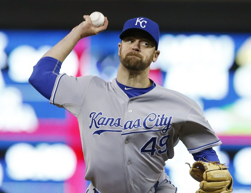 FILE - In this Oct. 2, 2015, file photo, Kansas City Royals pitcher Louis Coleman throws against the Minnesota Twins in relief in the seventh inning, in Minneapolis. The Dodgers and reliever Louis Coleman have agreed to a $725,000, one-year contract. Coleman's deal was announced Friday, Feb. 19, 20
