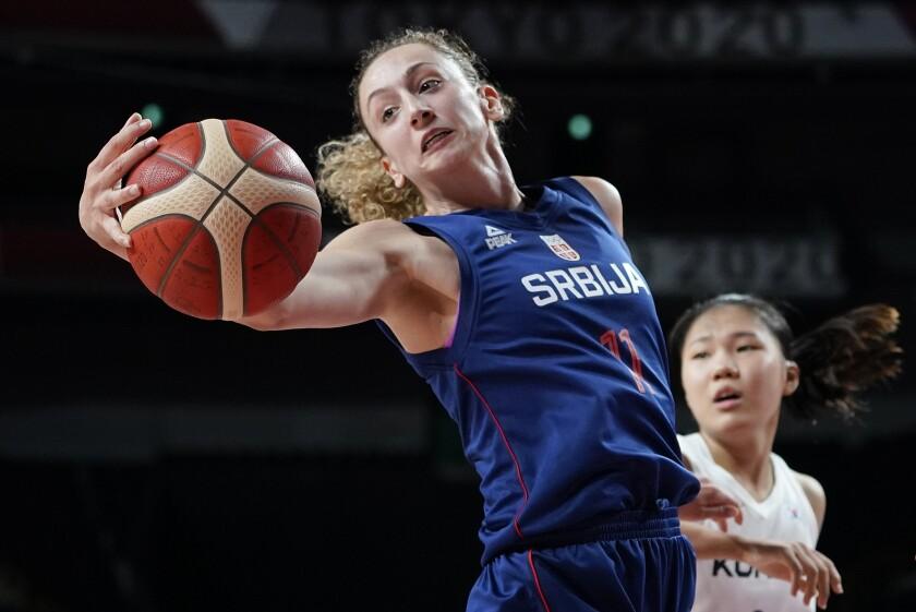 Serbia's Aleksandra Crvendakic (11) grabs a rebound against South Korea during a women's preliminary round basketball game at the 2020 Summer Olympics, Sunday, Aug. 1, 2021, in Saitama, Japan. (AP Photo/Charlie Neibergall)