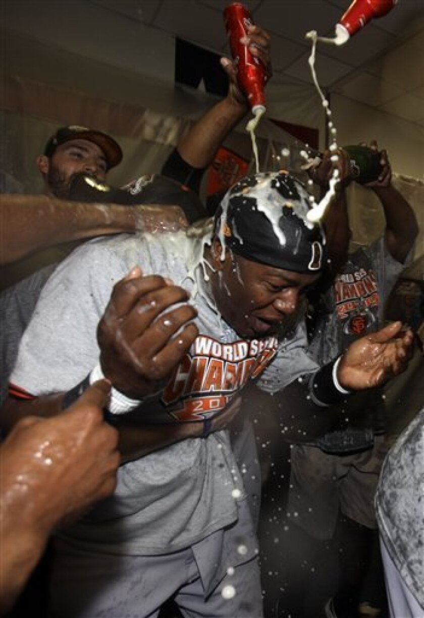 San Francisco Giants' Edgar Renteria celebrates with teammates after Game 5 of baseball's World Series against the Texas Rangers Monday, Nov. 1, 2010, in Arlington, Texas. The Giants won 3-1 to capture the World Series. (AP Photo/David J. Phillip)