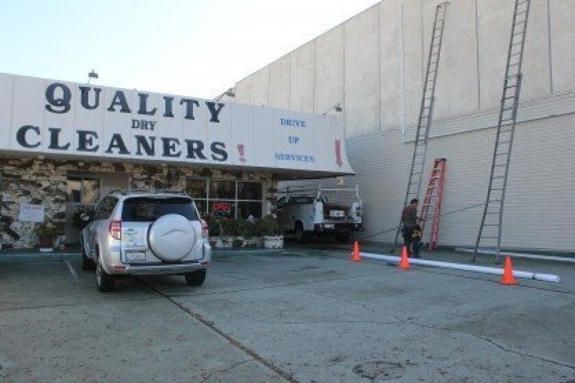 Workers prepare to install the La Jolla Community Foundation's 11th mural on Oct. 29.