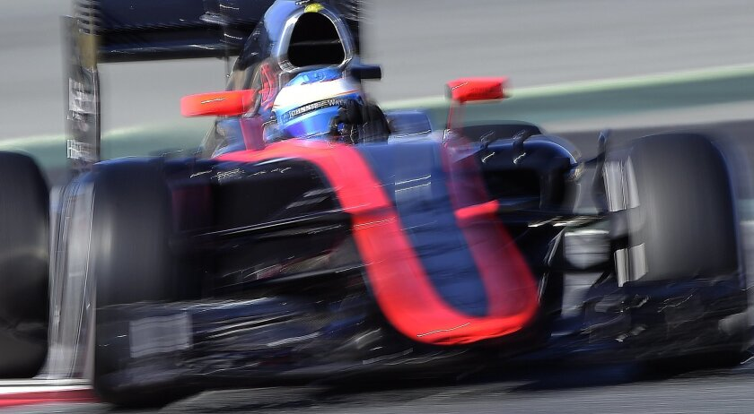 Fernando Alonso of Spain and McLaren Honda steers his car during the 2015 Formula One testing at the Barcelona Catalunya racetrack in Montmelo, Spain, Sunday, Feb. 22, 2015. (AP Photo/Manu Fernandez)