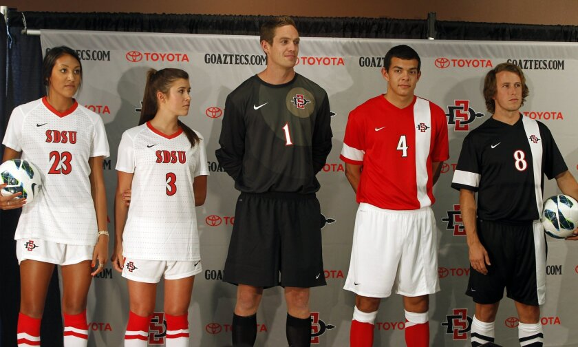 SDSU mens and womens soccer players model their refreshed logo and uniforms on Thursday at SDSU in San Diego, California.