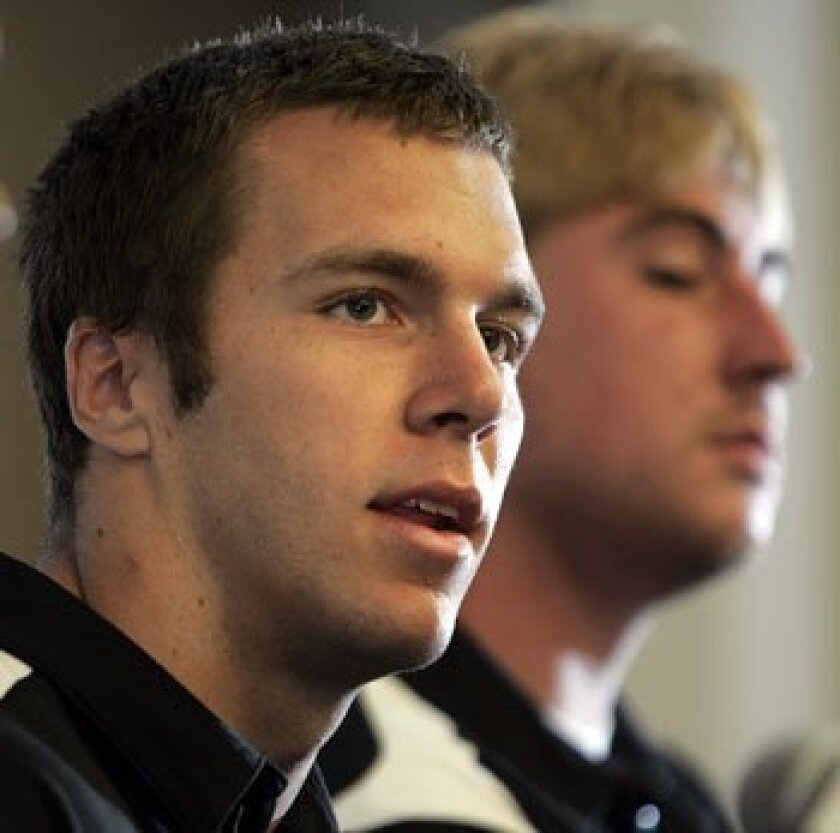 SDSU quarterback Ryan Lindley (left) and teammate Peter Nelson at the team's news conference Friday afternoon.