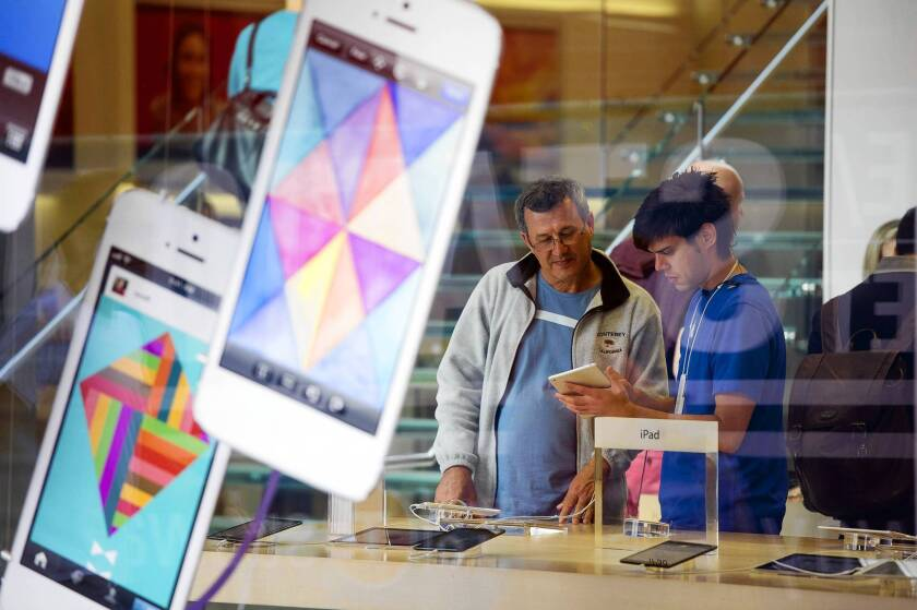 Low expectations cast gloom over Apple's earnings report