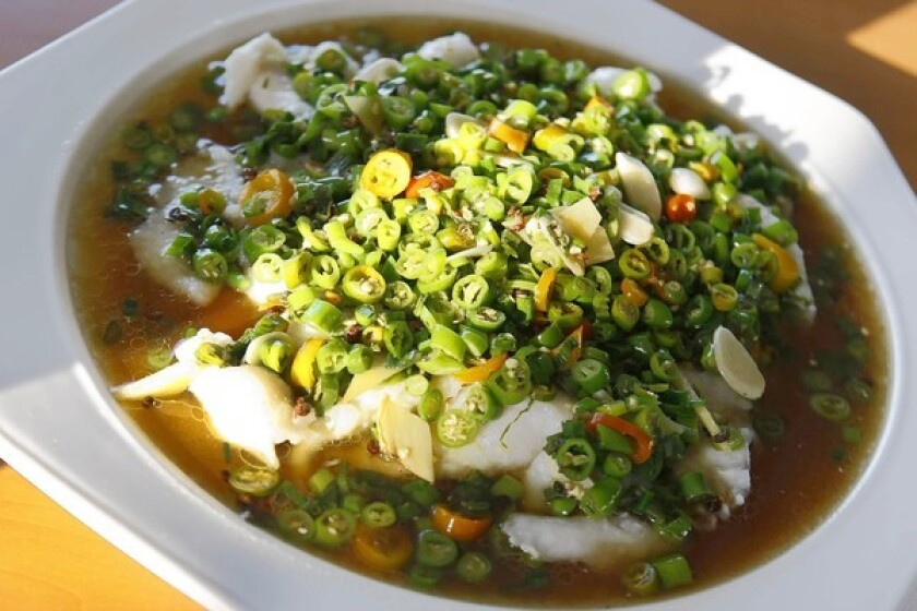 Sichuan-style fish is smothered with peppers at Taste of Chong Qing in San Gabriel.