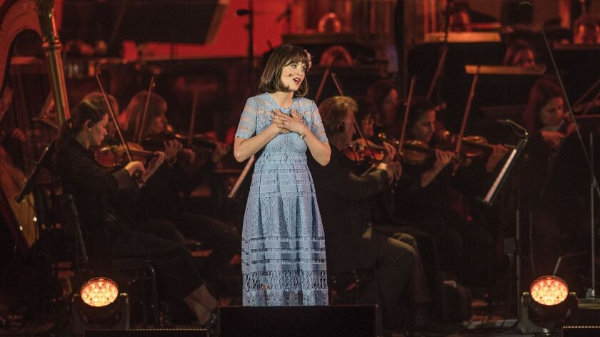 Zooey Deschanel plays Belle in the opening number of Disney's Beauty and the Beast In Concert at the
