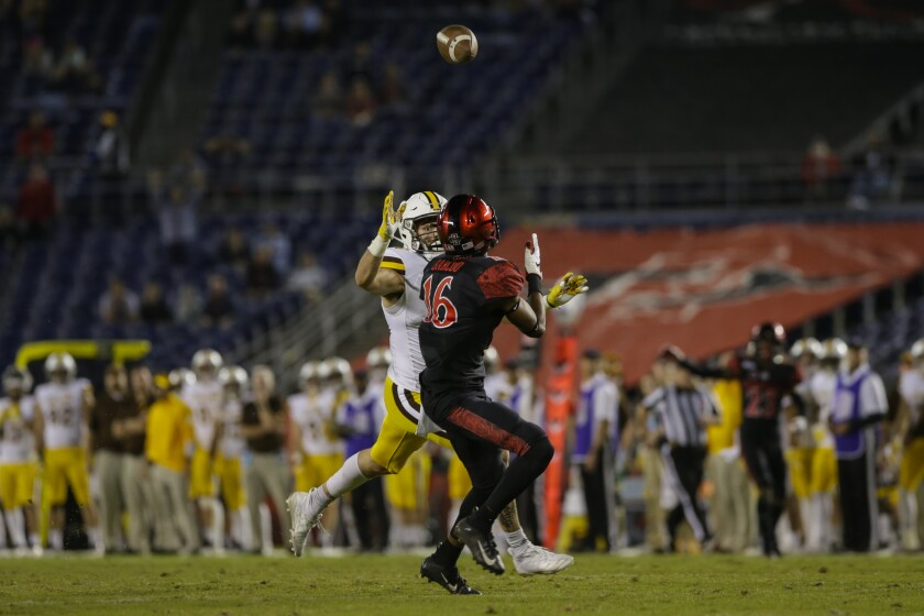 San Diego State cornerback Luq Barcoo intercepts a pass intended for Wyoming wide receiver Gunner Gentry in the fourth quarter of this season's Mountain West game.