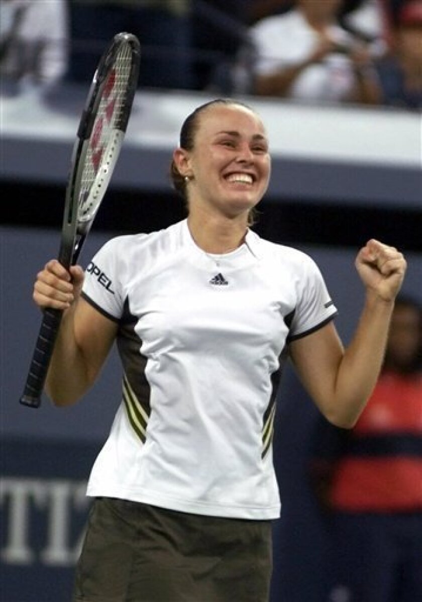 FILE - In this Sept. 10, 1999 file photo, Martina Hingis, of Switzerland, celebrates after defeating Venus Williams in the women's singles semifinals at the U.S. Open tennis tournament in New York.  Five-time Grand Slam singles champion Hingis heads the 2013 class for the International Tennis Hall