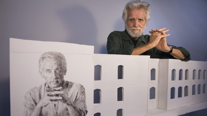 Artist Kent Twitchell in his studio with a sketch of Ed Ruscha. Twitchell is preparing to re-paint his famed mural of Ed Ruscha on the exterior of the American Hotel in the Arts District of Los Angeles.