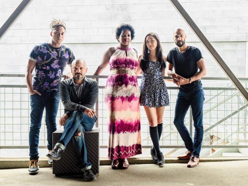 The cast of 'Seize the King' at La Jolla Playhouse includes Julian Parker, Jesse J. Perez (the King, seated), Saidah Arrika Ekulona, Jenapher Zheng and Luis Vega.