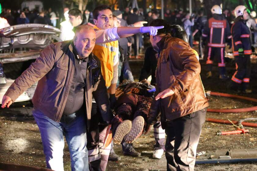 An injured person is carried away on a stretcher at the scene of a blast in the Turkish capital of Ankara on Sunday.