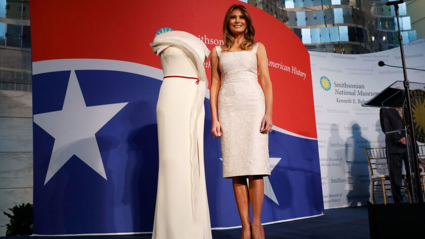 First lady Melania Trump donates her inaugural gown, designed by Herve Pierre, to the First Ladies' Collection at the Smithsonian's National Museum of American History, during a ceremony in Washington on Friday.