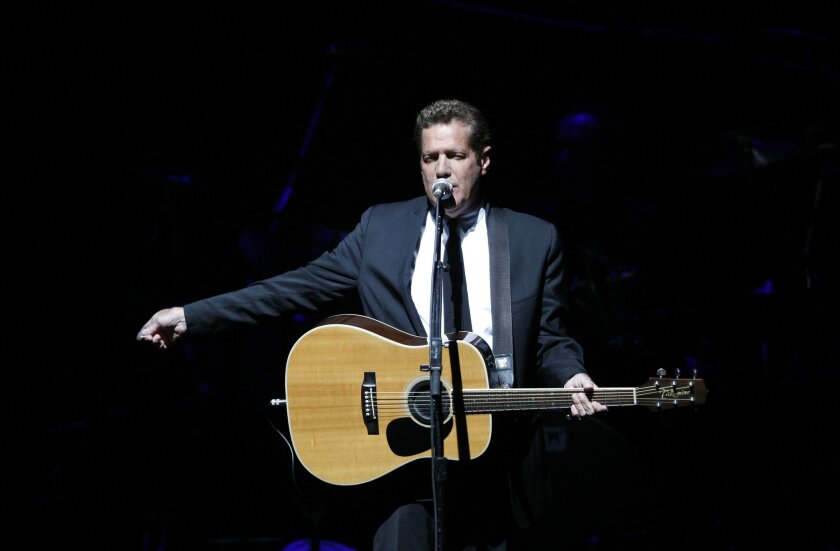 """FILE - In this June 30, 2009, file photo, Glenn Frey, of the the Eagles, performs at Belfast's Odyssey Arena in Northern Ireland. Frey, who co-founded the Eagles and with Don Henley became one of history's most successful songwriting teams with such hits as """"Hotel California"""" and """"Life in the Fast"""
