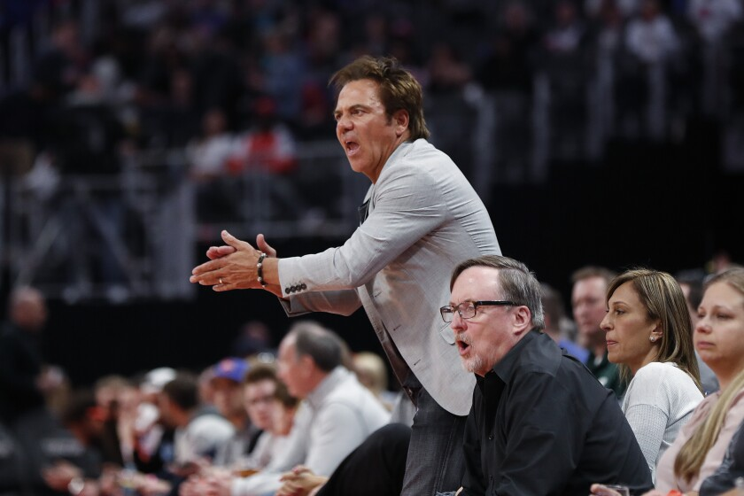 Detroit Pistons owner Tom Gores cheers during the NBA game against the Memphis Grizzlies in Detroit on April 9, 2019.