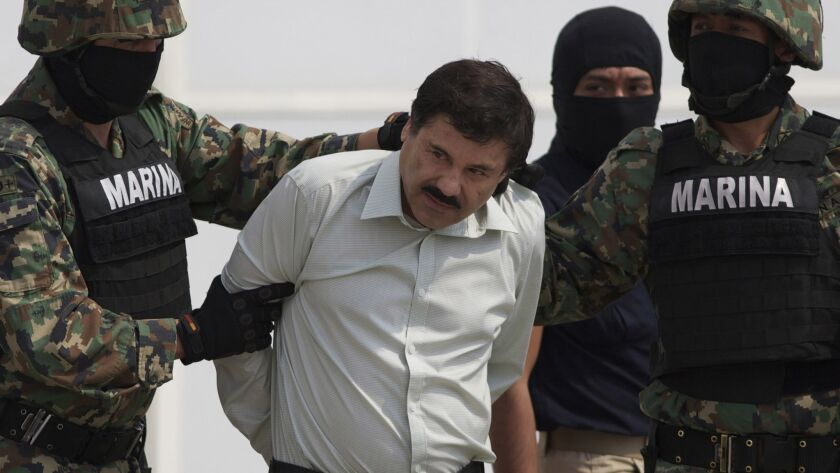 "Joaquin ""El Chapo"" Guzman is escorted by Mexican marines to a helicopter in Mexico City on Feb. 22, 2014."