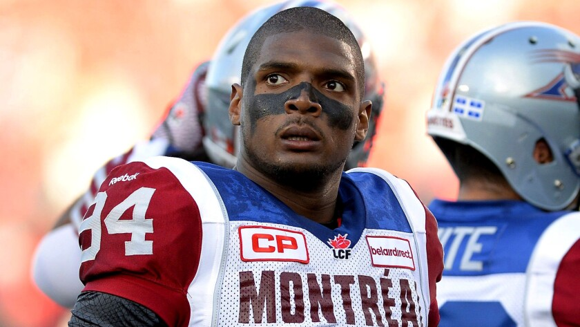Michael Sam joins Alouettes teammates during warmups for a game against Ottawa on Aug. 7.