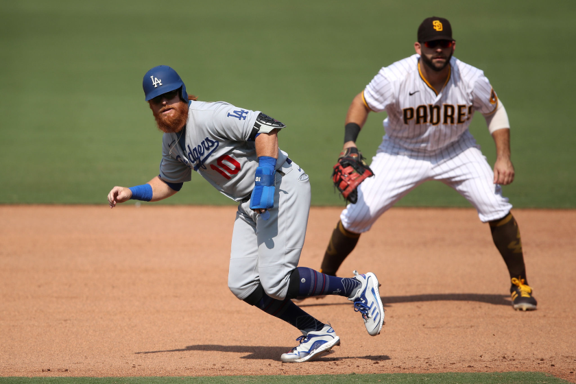 Justin Turner gets a leadoff jump at first base for the Dodgers in front of San Diego's Mitch Moreland.
