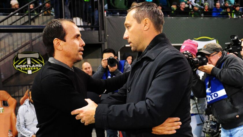 Head coach Oscar Pareja of FC Dallas (left) and head coach Caleb Porter of the Portland Timbers (right) greet each other before the match at Providence Park on November 22, 2015 in Portland, Oregon.