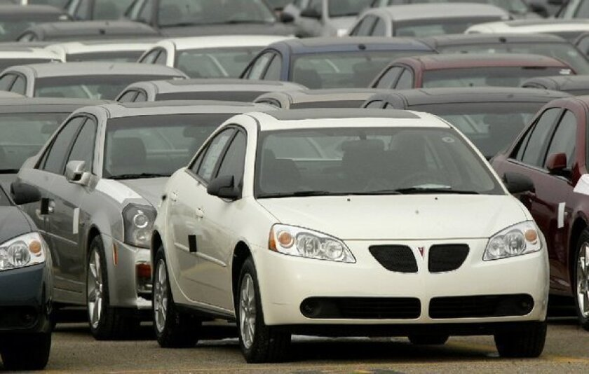 A Pontiac G6 outside the General Motors Orion Assembly plant in Orion Township, Mich. Federal regulators are investigating whether to broaden the recall of 8,000 2005 Pontiac G6s