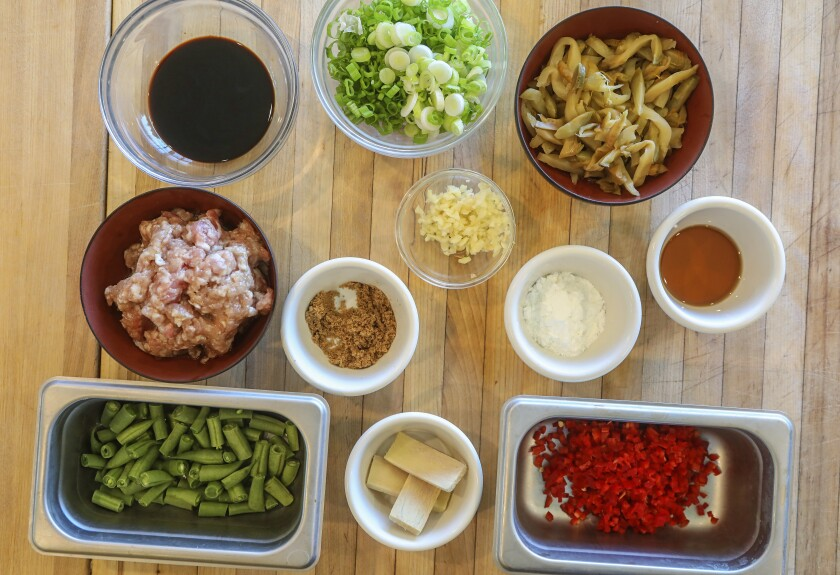 Ingredients for the topping on Congee With Pickled Radish, Ground Pork and Green Beans.