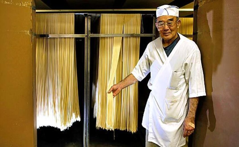 Owner Shoichi Sayano shows off one of his noodle drying closets at Nanka Seimen Noodle Co. in Vernon.