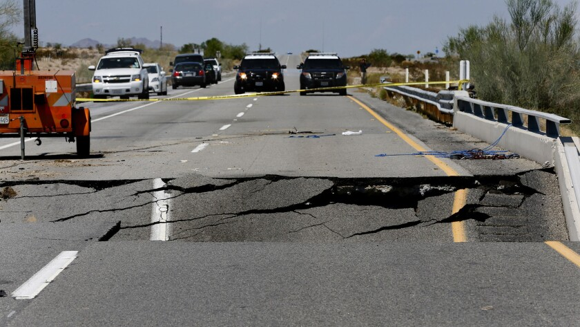 California Highway Patrol vehicles block a section of Interstate 10 between Coachella, Calif., and the Arizona border, where Sunday's flash floods washed out a bridge over a desert wash.