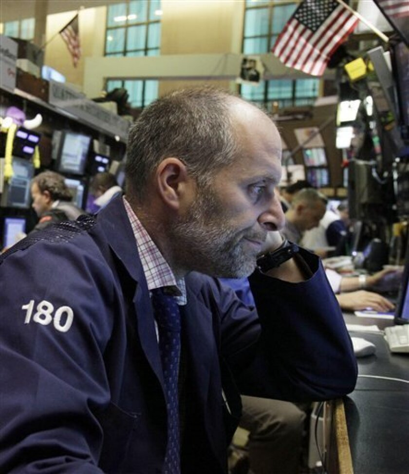 In this Oct. 4, 2011 photo, trader Jason Weisberg works on the floor of the New York Stock Exchang. Investors were cautious on Friday, Oct. 7, 2011, ahead of U.S. jobs figures, with stocks down slightly after enjoying a couple of bumper days on hopes of a Europe-wide plan to fix the banking sector.(AP Photo/Richard Drew)