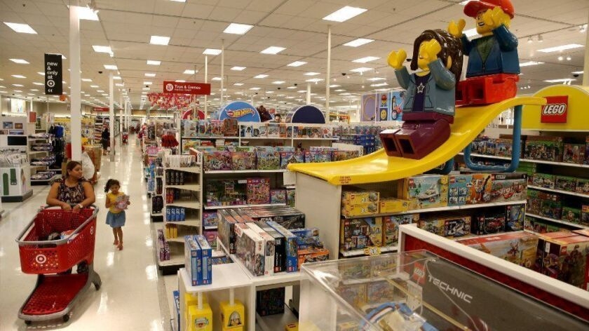 Larger-than-life Lego figures help to attract attention to the toy section at the Target store at Broadview Village Square in west suburban Broadview on Sept. 6, 2018.
