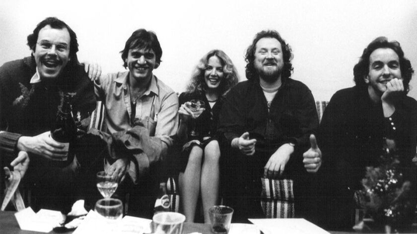 John Chelew, right, shown at McCabe's Guitar Shop in Santa Monica with, from left, musicians Stefan Grossman, Ralph McTell, McCabe's concert booker Nancy Covey and musician John Renbourn.