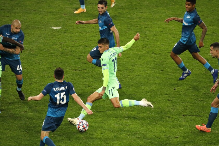 Lazio's Joaquin Correa kicks the ball during the Champions League Group F soccer match between Zenit St.Petersburg and Lazio at the Saint Petersburg stadium in St. Petersburg, Russia, Wednesday, Nov. 4, 2020. (AP Photo/Mike Kireev)