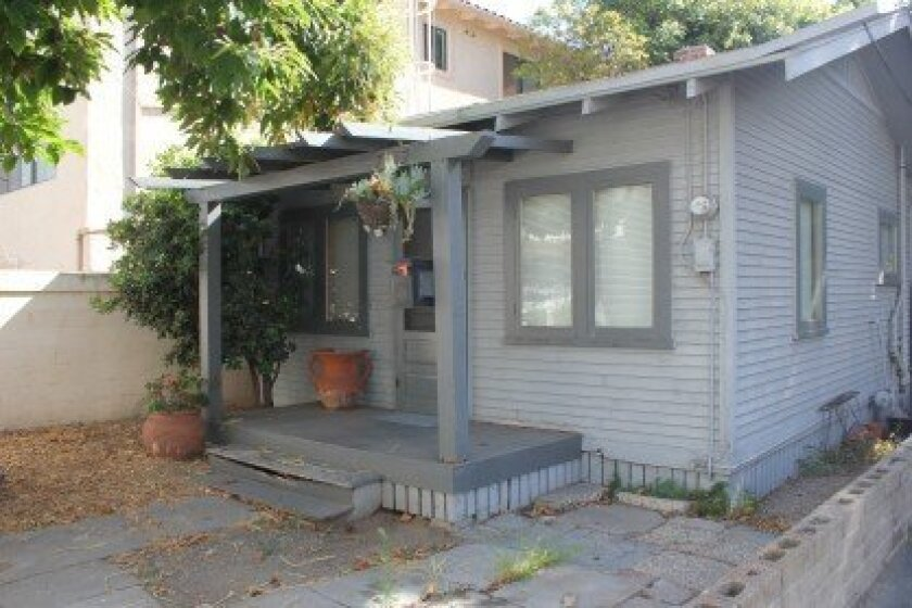 """7762 Bishops Lane is one of the two adjoining """"Lillian Lentell Cottages,""""which have historic designations from the City of San Diego. This one was built in 1913."""