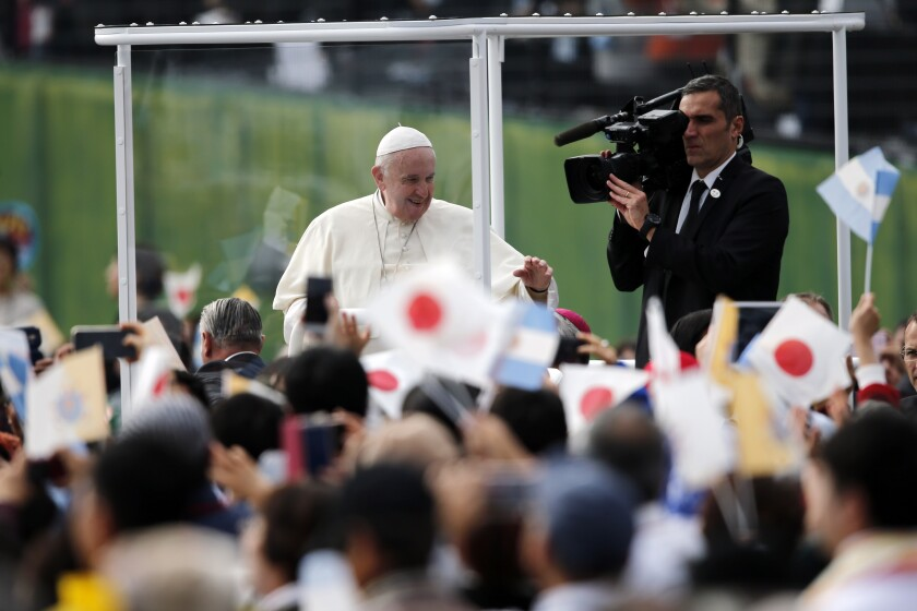 Pope Francis waves from his popemobile as he celebrates Mass in Nagasaki, Japan, on Sunday.