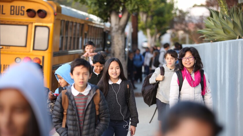 L.A. Unified students walk into Thomas Starr King Middle School in East Hollywood in December. How will money be spent on them this year?