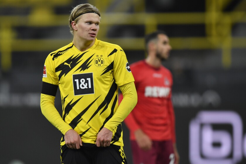 Dortmund's Erling Haaland reacts during the German Bundesliga soccer match between Borussia Dortmund and 1.FC Cologne in Dortmund, Germany, Saturday, Nov. 28, 2020. (AP Photo/Martin Meissner, Pool)