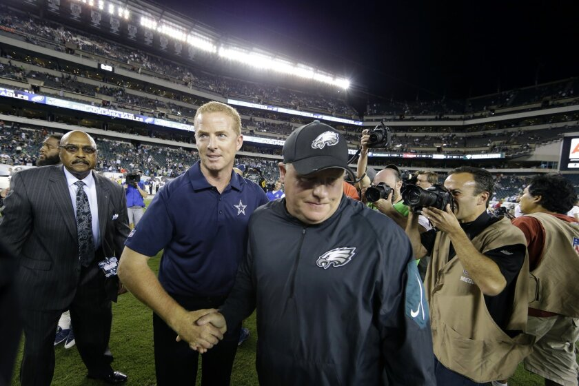 Dallas Cowboys head coach Jason Garrett, left, greets Philadelphia Eagles head coach Chip Kelly after an NFL football game, Sunday, Sept. 20, 2015, in Philadelphia. Dallas won 20-10. (AP Photo/Matt Rourke)