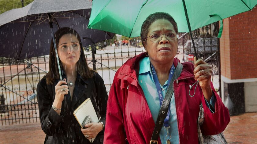 "Rose Byrne as Rebecca Skloot and Oprah Winfrey as Deborah Lacks in the film ""The Immortal Life of He"