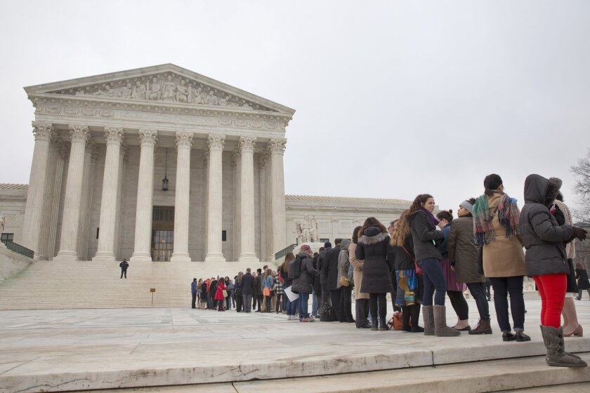 People stand in line hoping to enter the Supreme Court in Washington, on Dec. 9, as the court hears oral arguments in the Fisher v. University of Texas at Austin affirmative action case.