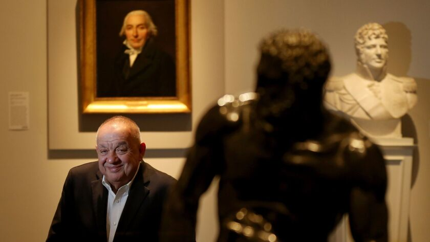 """J. Patrice Marandel, with """"Portrait of Jean-Pierre Delahaye"""" over his shoulder, retired Friday as chief curator of European painting and sculpture at the Los Angeles County Museum of Art."""