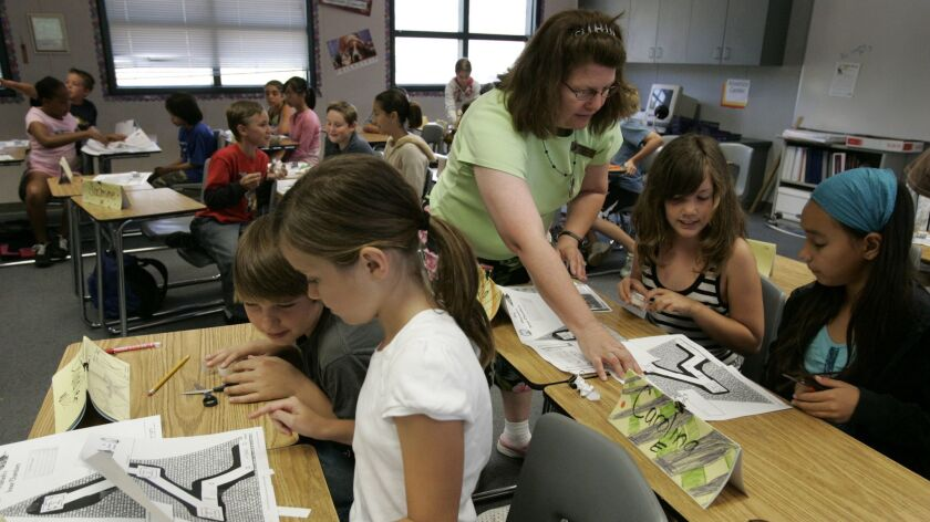 Students prepare a science experiment during summer classes at Hillsdale Middle School of the Cajon Valley Union School District. Cajon Valley was one of seven districts that were identified in the state's school ratings as needing improvement for the second year in a row.