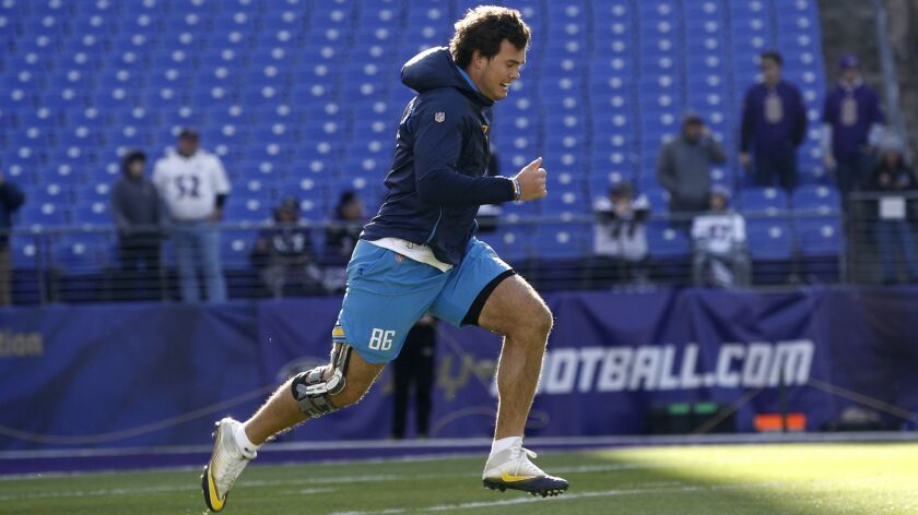Chargers tight end Hunter Henry runs on the field before last week's wild card playoff game against the Ravens.
