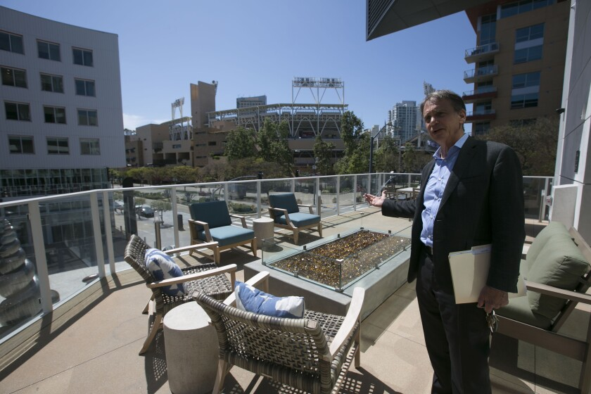 The amount of money that San Diegans spent on rent has increased greatly over 10 years. Pictured is Greystar senior managing director Jerry Brand at one of the common areas at the Park 12 apartment complex across the street from the entrance to Petco Park.