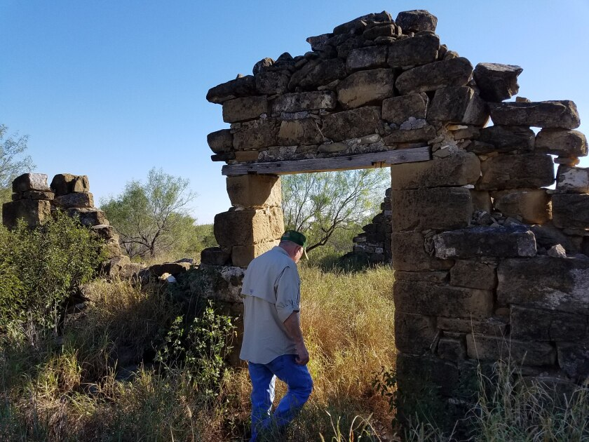 Mauricio Vidaurri walks among the ruins of a cabin where his father was born in 1925
