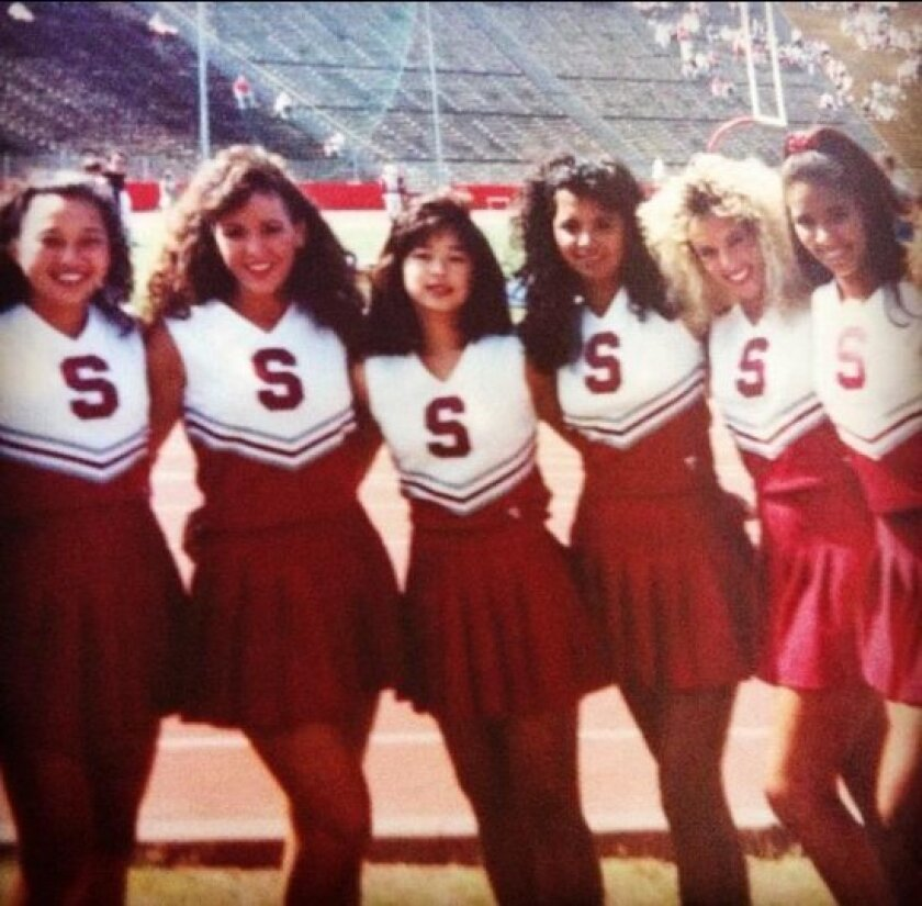 Assemblywoman Lorena Gonzalez, second from left, knows firsthand the rigors of being a cheerleader from her days on the Stanford squad and in high school.